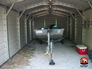 Boat storage using a carport