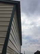 Side view of trim on a double wide commercial metal building.