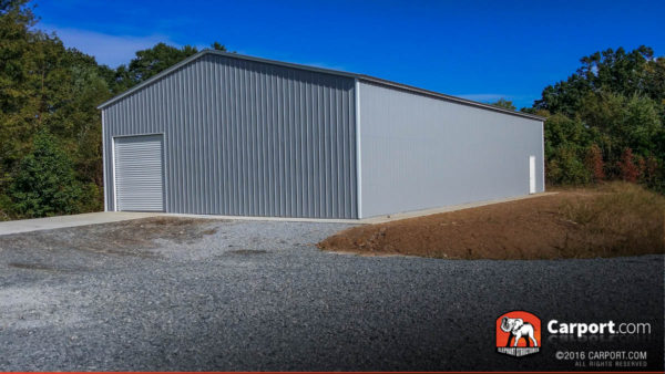 Commercial metal garage building with grey walls and ends, white trim.