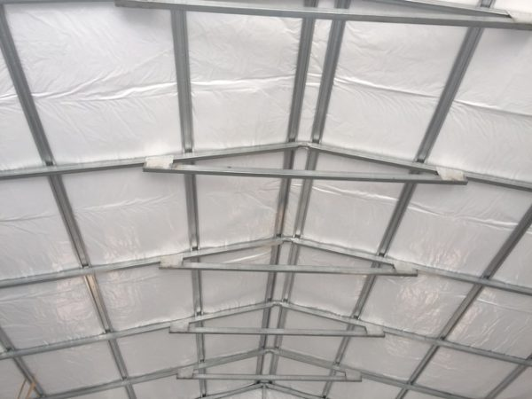 Framing of a commercial metal garage, insulation, roof.