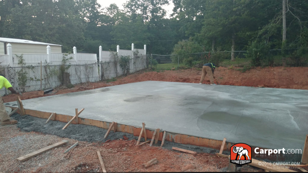 Concrete foundation is poured, smooth, and dry.