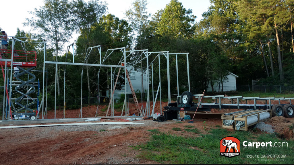 Scaffolding is used to apply the truss system to framing already completed.