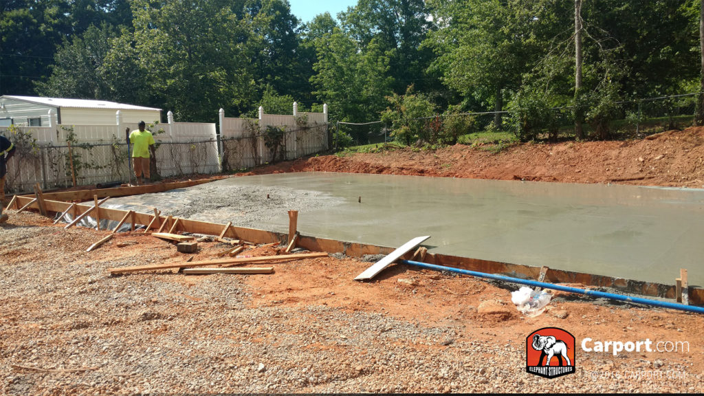 Concrete foundation still being smoothed out.