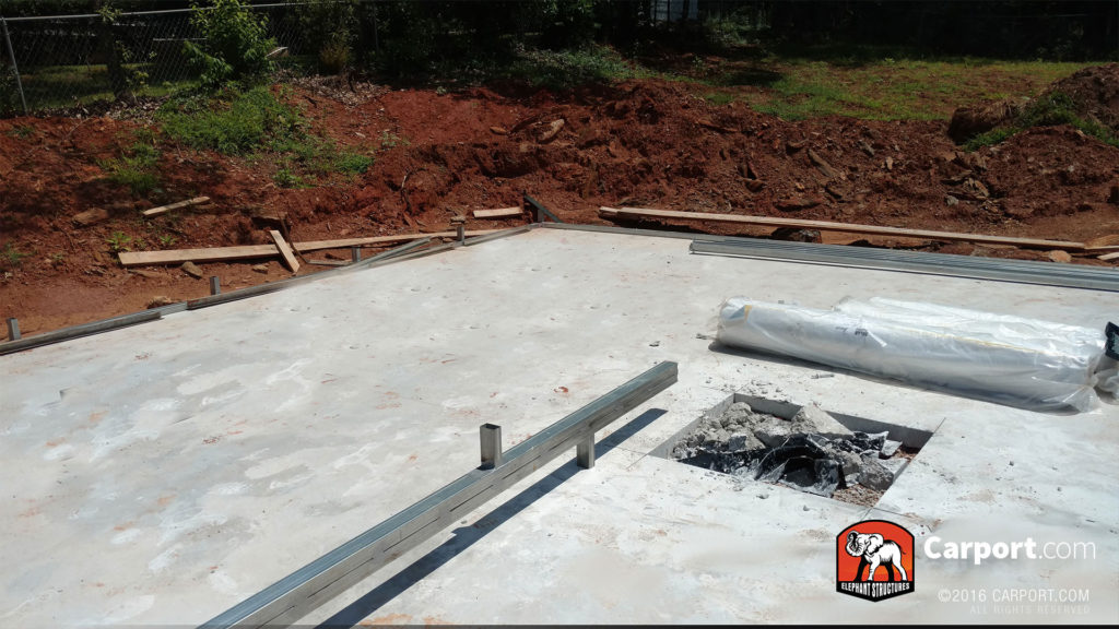 Concrete foundation and the beginning of the frame.