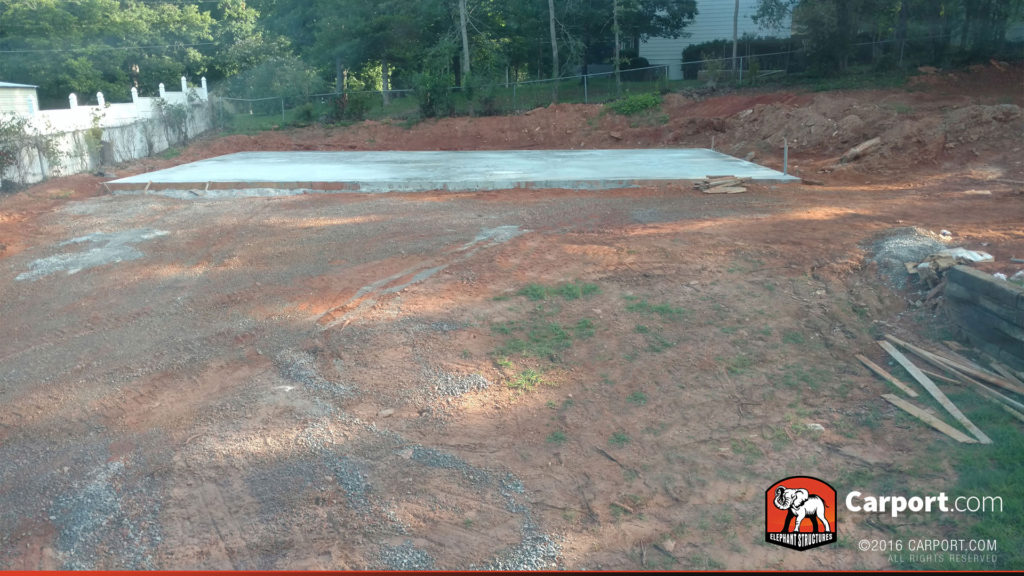 View of the concrete foundation from the driveway.