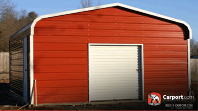Red metal garage building with regular style roof