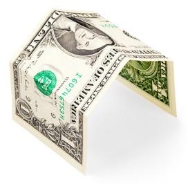 dollar bill folded into the shape of a carport.