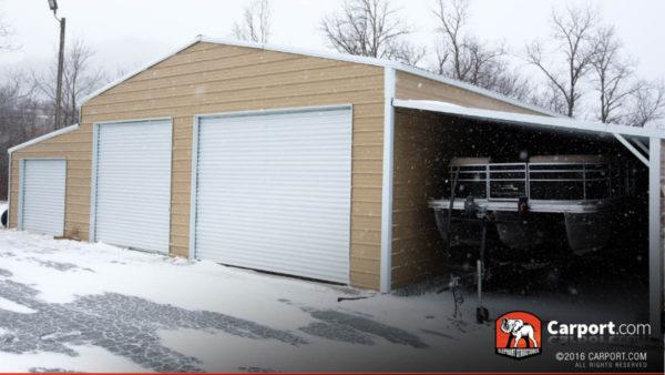 Ridgeline barn with boat storage and three roll up garage doors.