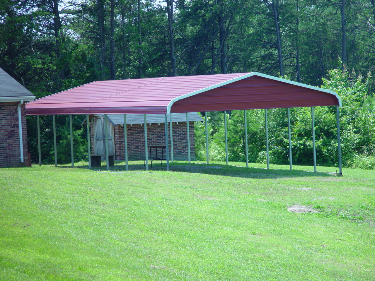 Mobile home cover with red gables and roof, with white trim.
