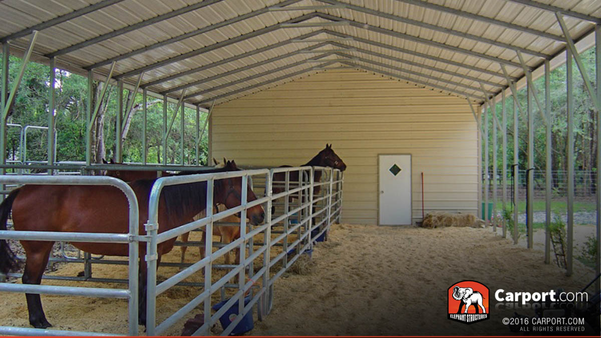 Horses in a custom gate installed under a metal shelter stable.