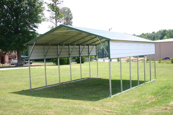 White Metal Patio Cover with green trim and extra panels on the side.