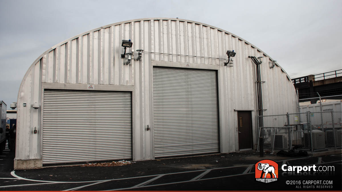 minnesota carports metal buildings and garages s model commercial steel arch building with two roll up garage doors in the front