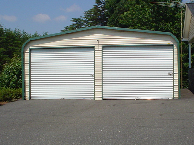 Standard two car metal garage with two roll-up garage doors.