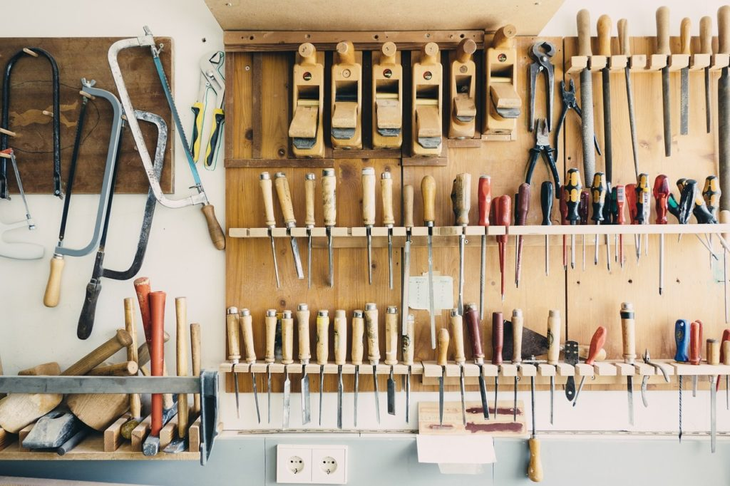 organization on wood shelving in a garage
