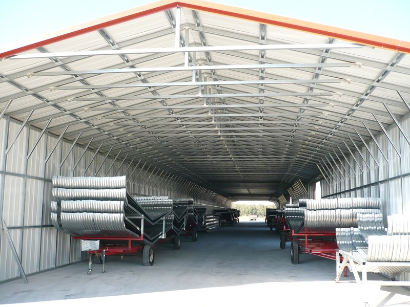 Tractor trailer carport with triple wide capability and red trim.
