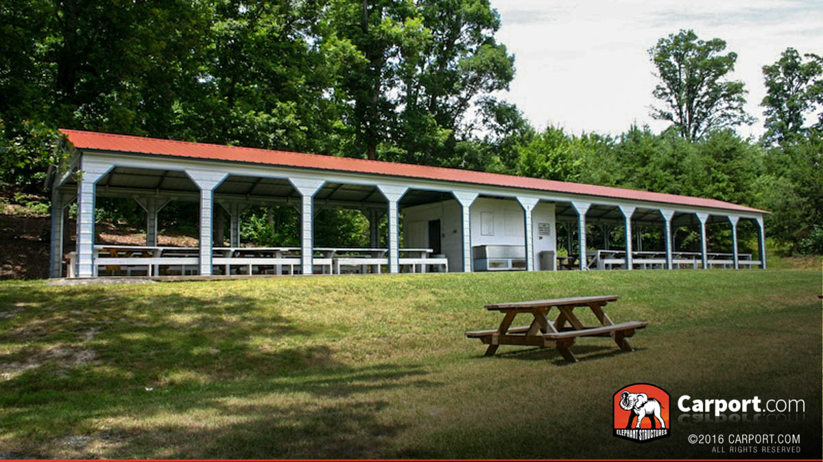 Eleven bay metal picnic shelter pavilion with picnic tables inside.
