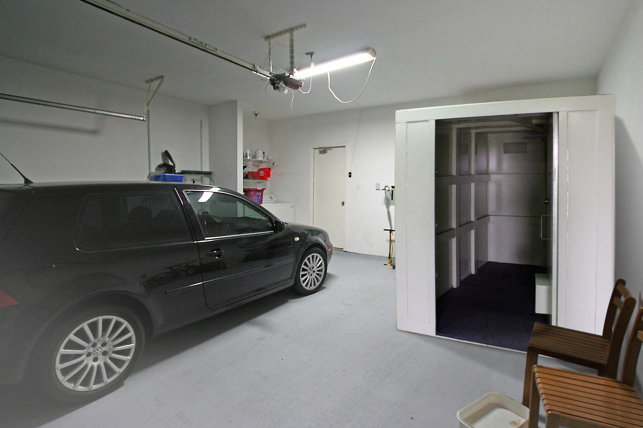 Car parked next to a safe room