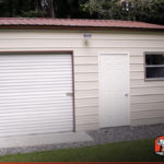 Another front facing view of this vertical style metal garage workshop.
