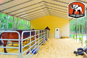 Metal barn crafted from a carport with horse gating inside.