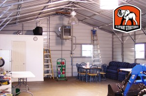 The inside of a metal carport made easy to maintain with after market lights installed.