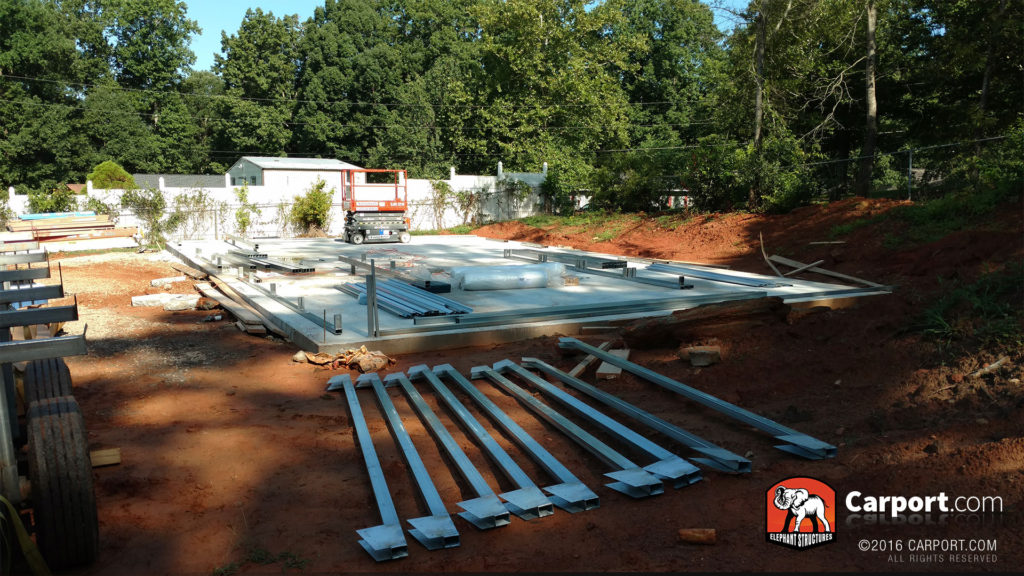 Concrete foundation with bracing and framing laid out to be constructed.