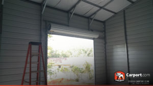 Interior of the garage with view of the roll-up garage door.