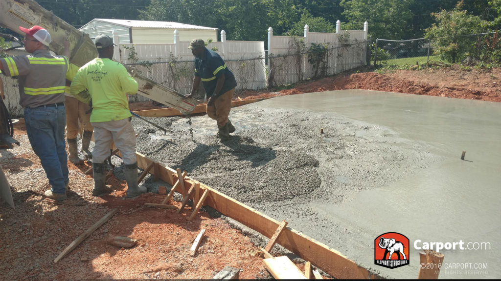 Concrete being poured into the foundation.