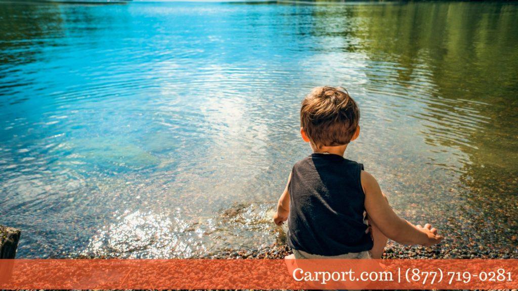 Kids playing in clean mountain lake water