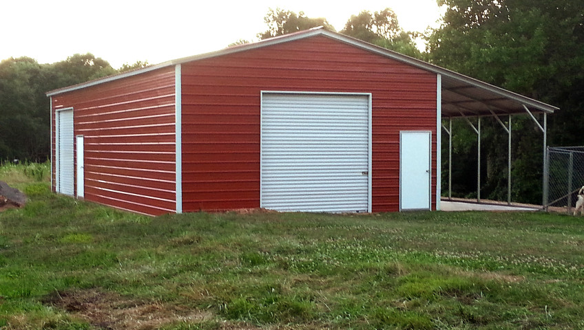 Metal building with valley style roofing and one lean to on the side.