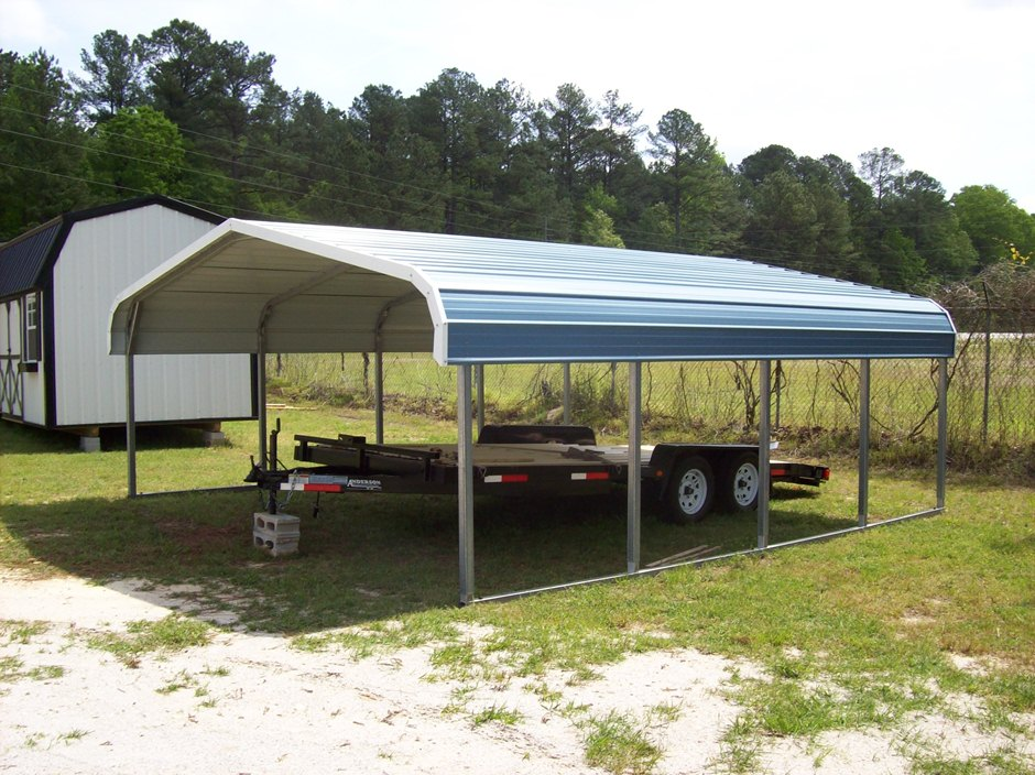 Bass boat metal carport cover with trailer parked underneath.