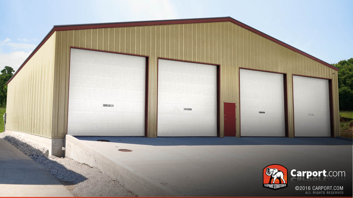 Commercial metal building with four roll up garage doors and one walk-in all on the front.