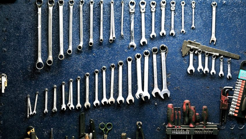 blue wall with wrenches