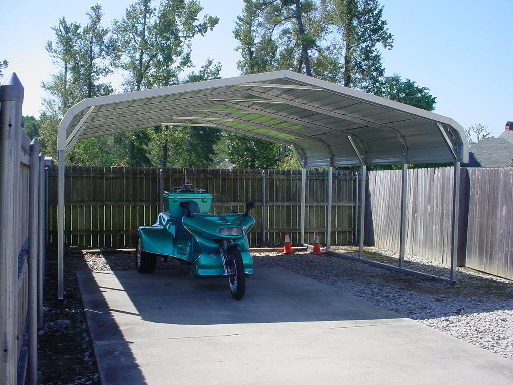 Motorcylce carport cover with white trim and room for two carports.