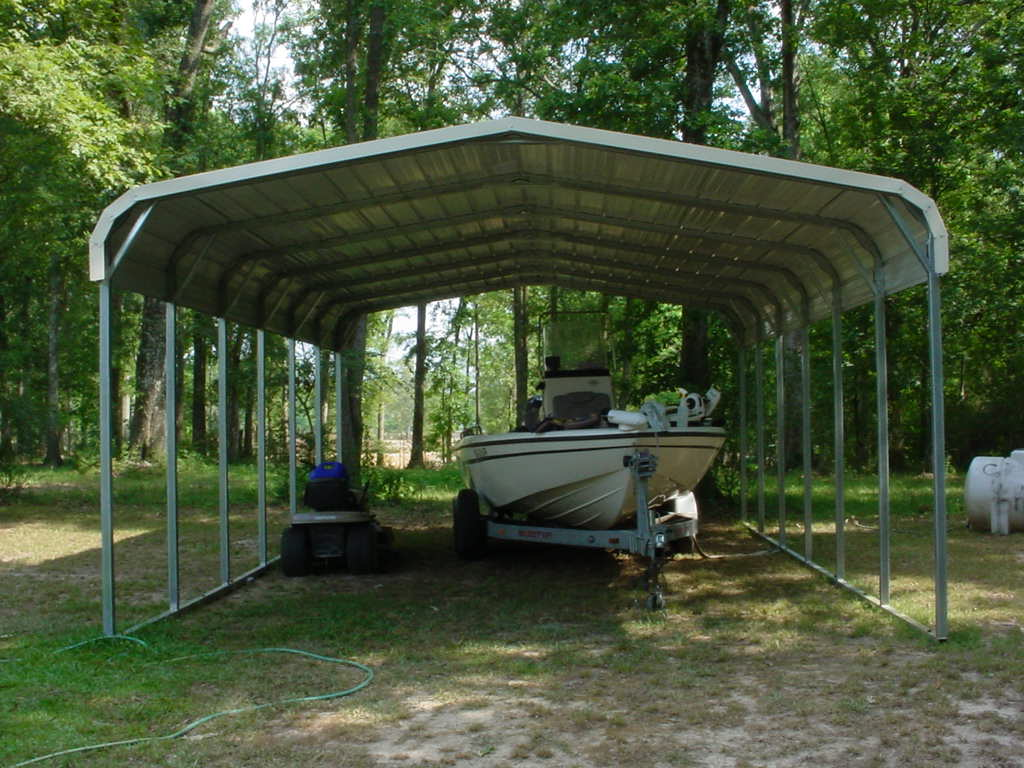 Single wide tall carport with boat parked underneath.