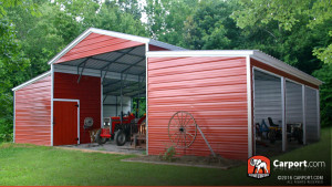 Ridgeline barn with customized end wall enclosures and tractor parked inside.